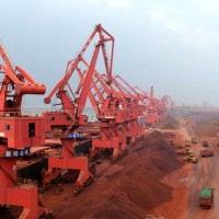 What is the new iron ore price range?