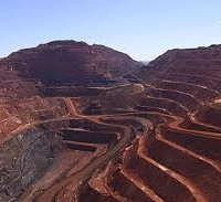 Iron ore twirls higher