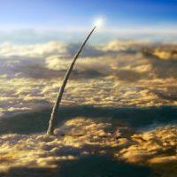 Golden rocket departs atmosphere