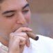 Drew Pavlou smokes fat cigar